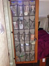 Photo: Shoe organizer on inside of bathroom door