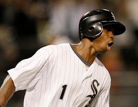 Photo: Chicago White Sox's Juan Pierre celebrates his game winning single off Cleveland Indians starting pitcher David Huff, scoring Gordon Beckham during the 14th inning of a baseball game Wednesday, Aug. 17, 2011 in Chicago. The White Sox won 8-7. (AP Photo/Charles Rex Arbogast)