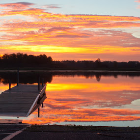 On the way to work by Jamie Rabold - Landscapes Sunsets & Sunrises ( clouds, water, boat landing, waterscape, sunset, st louis  river, duluth mn, dock, river )