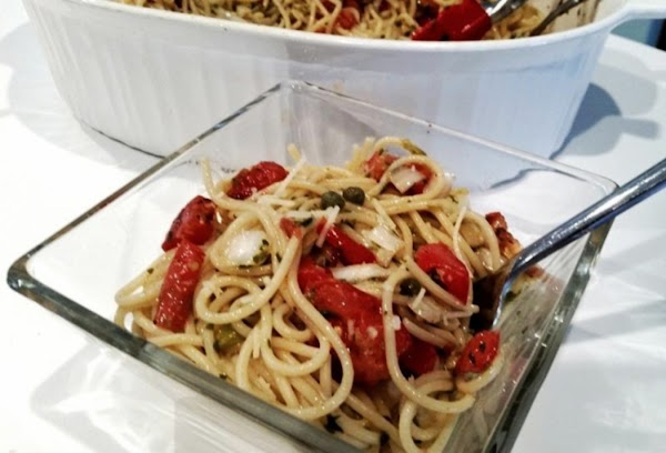 Cook pasta, drain and mix with refrigerated dressing mixture. Garnish with Parmesan & serve...