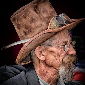 Mr. Flint by Marco Bertamé - People Portraits of Men ( dapper, glasses, beard, brown, moustache, feather, steampunk, man, portrait, profile, hat,  )