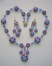 "Photo: PCC-111. Polymer Clay cane beads - this is a very special design. Plus Swarovski Crystals, Glass beads. Necklace and earrings set. The cane beads Diameters are 11/4"", 1"", 7/8""and 3/4"" and 1/2"". They are sanded and polished very smooth. The necklace is 26"" long. The earrings are 3.5"" long. $250.00."
