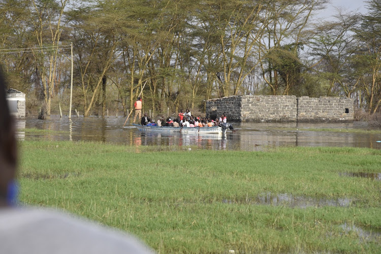 Nakuru residents enjoy a boat ride at a flooded section of Barut farm.