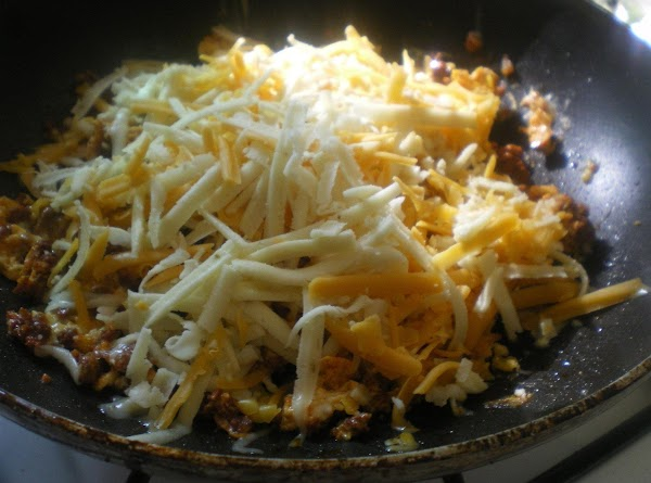 Stir until eggs are soft-scrambled.  Turn off heat, top with cheese, and cover...