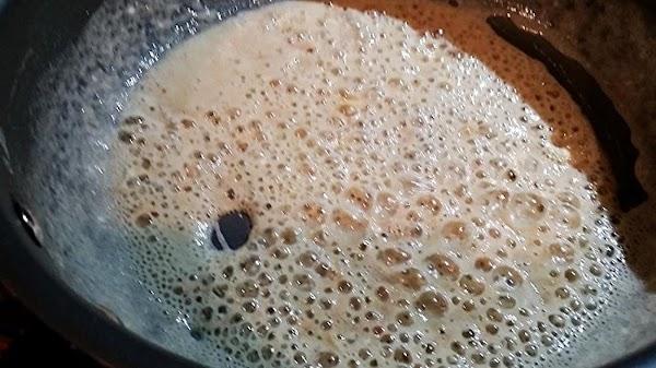 In a large saucepan, melt butter over medium heat. Stir in garlic and cook...