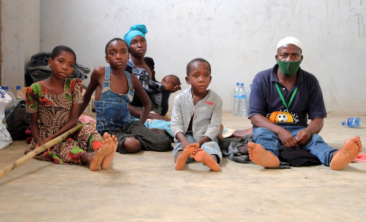 Adelino Alberto and his family, who fled an attack claimed by Islamic State-linked insurgents on the town of Palma, wait at a temporary displacement centre in Pemba, Mozambique, April 3 2021. Picture: REUTERS/EMIDIO JOZINE
