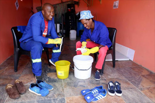 HOME BUSINESS: Vuyani Mahlasela and his employee Phakamile Bange, from Mdantsane, busy at the shoe laundry Picture: SIBONGILE NGALWA