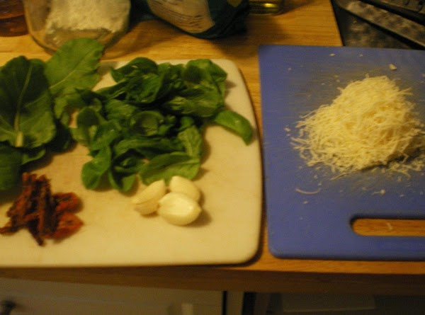 Snip stems off chard and basil.  Peel garlic and grate Romano Cheese.