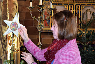 Photo: Kate York placing the star at the top of the tree in Ashbourne Church in 2015