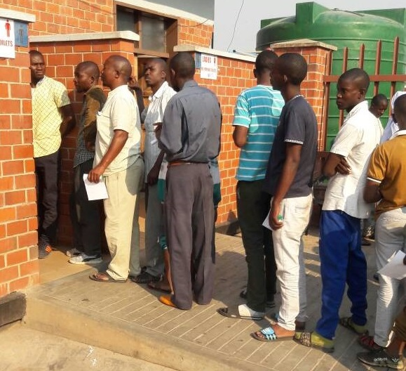 Travelers queue at the Zimbabwe-Zambia border post for poo tests amid ongoing cholera outbreak.