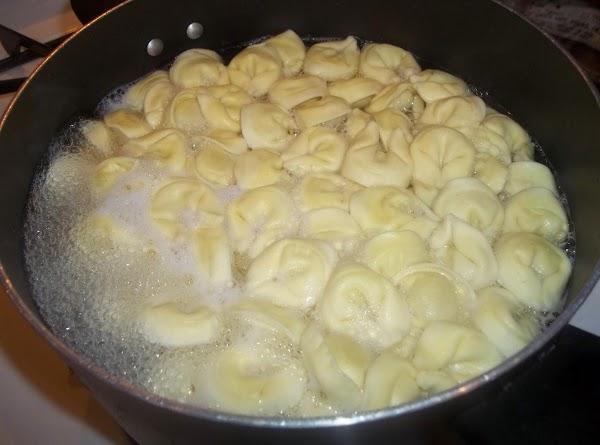 Prepare tortellini according to package. Drain