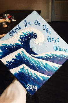 """A graduation cap that reads """"catch ya on the next wave."""""""