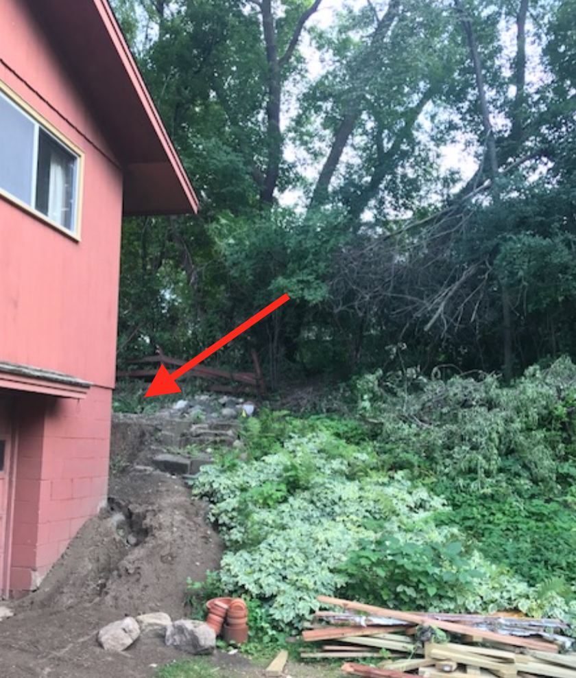 House on low spot susceptible to water run-off.