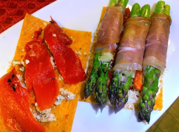 Top off tomato side with wrapped proscuitto