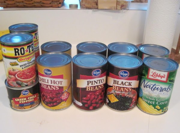 Add corn, chili beans, green chilies, & chopped tomatoes (I don't drain any of...