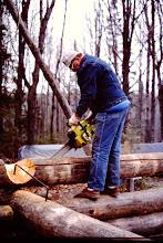 Photo: Fred cutting groove in log.