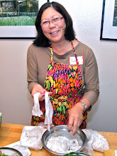 Photo: Barbara separating the packaged fresh rice noodles into individual strands