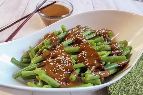 Sesame Seeds Sprinkled Onto Green Beans.