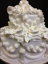 Photo: 2-Tier Elegant Wedding Cake: white whipped cream frosting w/edible pearls, traditional border, and frosting roses.