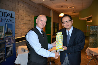 Photo: President Rod Potter thanking Jason Koo, Senior Technical Sales Engineer Stulz Air Technology