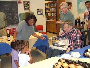 Photo: Pat's grandchildren talk to Michael
