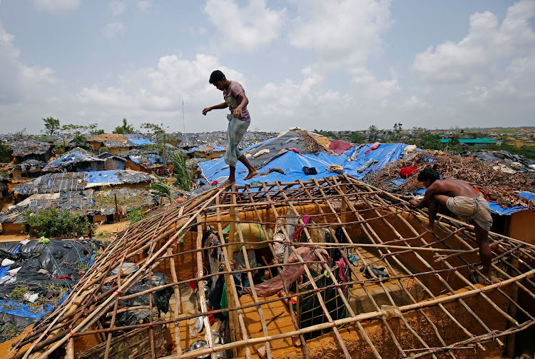 Rohingya refugees rebuild their makeshift house, which was destroyed by Cyclone Mora, at the Kutupalang Makeshift Refugee Camp in Cox's Bazar, Bangladesh June 1, 2017. Picture: REUTERS