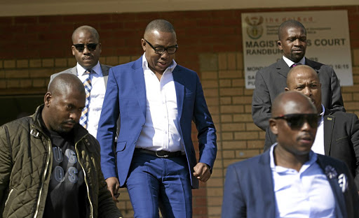 TOUGH GUYS  Deputy Minister of Higher Education and Training Mduduzi Manana leaving the Randburg Magistrate's Court. Charged  with assaulting three women, he  has been granted bail of R5000.