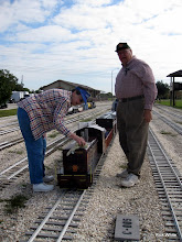 Photo: Mary Lou and Jerry Schoenberg polishing the PRR loco.    SWLS at HALS 2009-1107