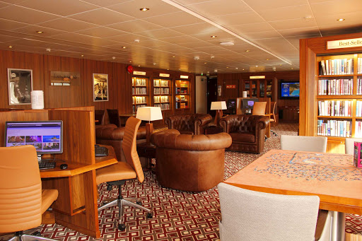 prinsendam-Explorations-Cafe-library.jpg - Find some solitude and a good read in the Explorations Café Library on ms Prinsendam.