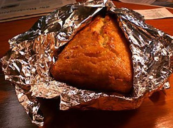 Wrap in aluminum foil to keep in the moisture.  Ideally, refrigerate the loaves...