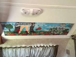 Photo: Custom wall art (craftily hiding wall damage from cabinet removal)