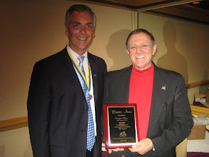 "Photo: President Joe Johnsonl presented President-Elect Dennis Micare the ""President's Award"" for Dennis' work as Golf Tournament Chairman for the 2008-2009 Rotary Year"