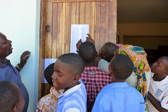 Photo: Bethany children and care workers looking for their English exam results
