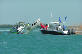 Photo: Barrel roll causes sinking at turn 3.  The driver is being extracted from the vessel.
