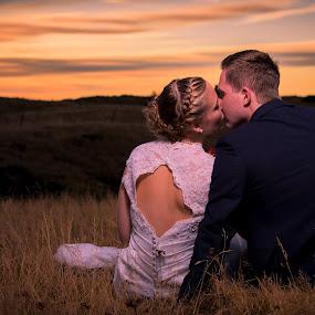 First day of winter. by Sigurður Brynjarsson - Wedding Bride & Groom ( grass, beautiful, holy, husband, sun, sit, kiss, iceland, winter, sunset, sunny, wife, wedding, woman, couple, man )