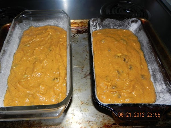 Grease and flour your pans. You can use two large loaf pans or 3...