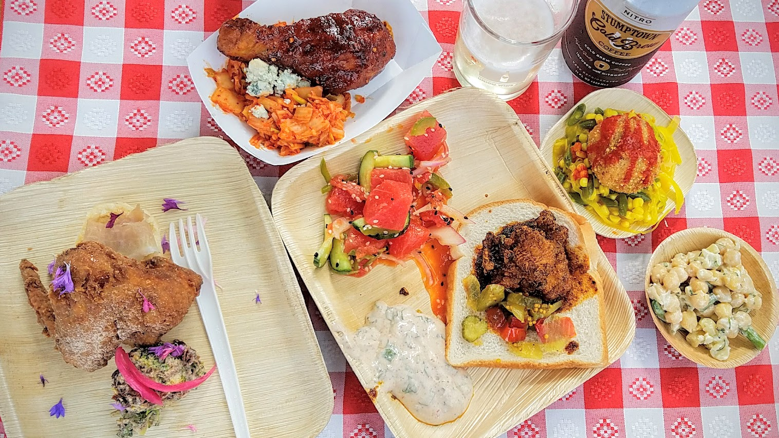 All the savory dishes at Feast PDX Go Get You Some Picnic including Korean Fried Chicken by Tommy Habetz; Hot chicken with vaudovan seasonings (and white bread and pickles) along with Salad Sauce and Tequila watermelon salad with sesame cucumber and jalapeno by Gabriel Rucker; Lard fried chicken wing accompanied by a sorghum butter and country ham biscuit and after-church broccoli salad by Mya Lovelace; and Chicken Fried Pigtails, Hot Sauce, Stinky Chow Chow, and Three Bean Salad by Matthew Jennings