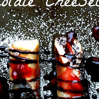 Chocolate Cheesecake Chimichangas with a Strawberry Reduction Sauce.