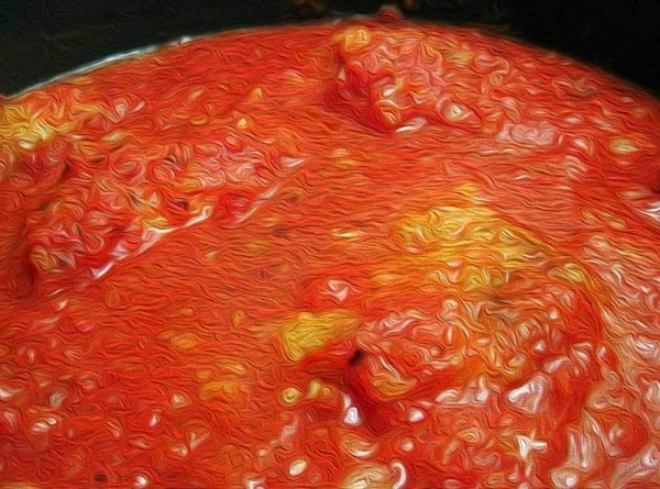 Bring to a slow simmer, and allow the tomato base to cook, uncovered for...