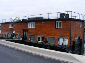 Photo: Now here's a houseboat that really looks like a house on a boat!