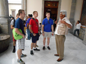Photo: Our museum guide talks to Lang, Moran, Lukas and Borio.