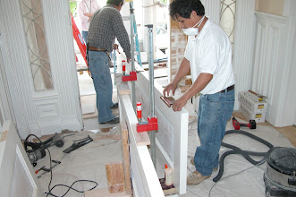 Photo: September 2006 - Month 37: Zenom and Francisco installing hardware on the front doors