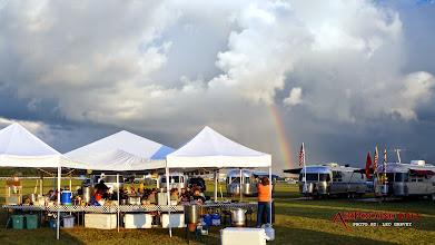 Photo: Once it passes not only do we have a rainbow, but it's time for Pot Luck dinner.  There's a lot of gourmet food under that tent though, don't be fooled by the title.