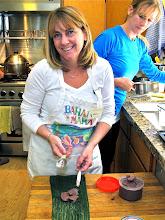 Photo: Melissa preparing to wrap shrimp paste for roasting