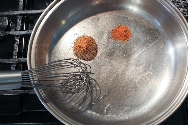 Spices and oil in a saute pan.