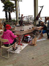 Photo: spinning and weaving at the beach with my saori piccolo looms and my louet victoria