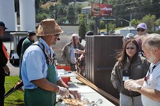 Photo: Don serving salmon