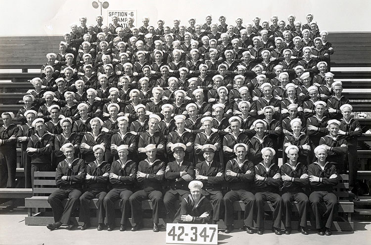 1942-boot-camp-san-diego-ADJ;-seated-at-center,-behind-and-r-of-the-blonde-kneeling-guy