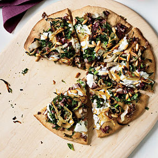 Whole-Wheat Pizza with Onions and Bitter Greens.