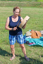 Photo: 11:27 AM: Cathy drumming to celebrate the eclipse.